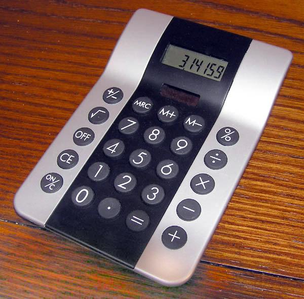 This picture shows a simple calculator with the value of Pi written on the screen.