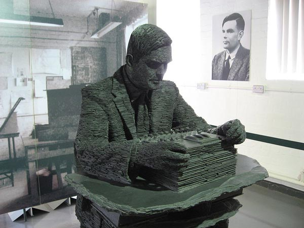 This photo shows a slate statue of Alan Turing found in Bletchley Park, England. Born in 1912, British mathematician Alan Turing is famous for his contributions to computer science, artificial intelligence, computational logic and cryptanalysis (code breaking).