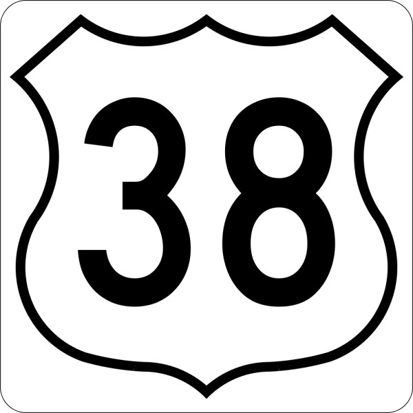 This picture shows the number thirty eight written in black inside a white badge symbol with a black outline.