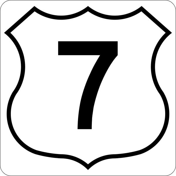 This picture shows a black number 7 inside a badge symbol.