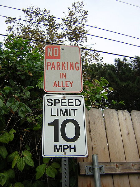 This photo shows the number 10 written on a speed limit sign.