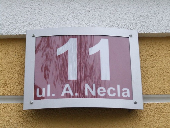 This photo shows the number 11 written on a plaque.
