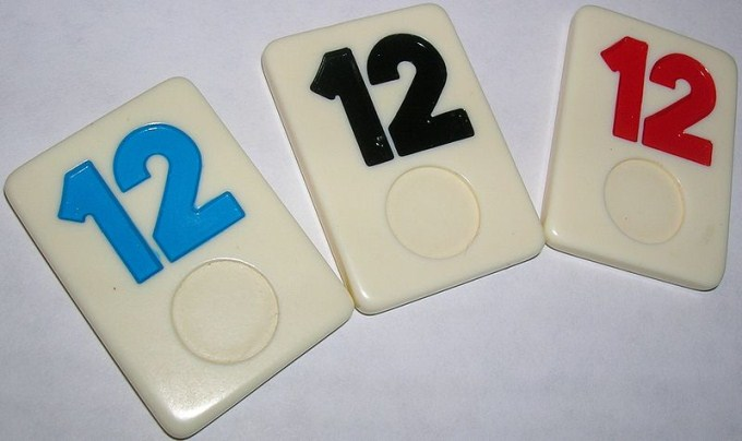 This photo shows the number 12 written on a set of Rummikub tiles.