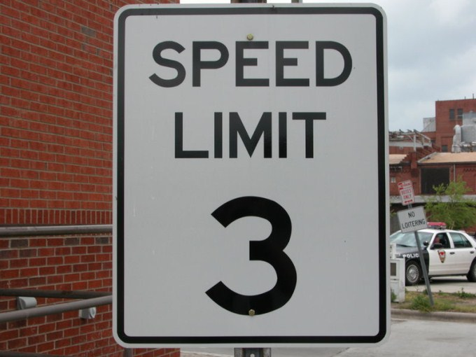 This photo shows the number 3 written on a speed limit sign.