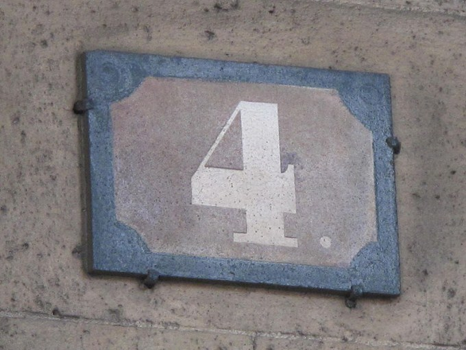 This photo shows the number 4 on a stone plaque.