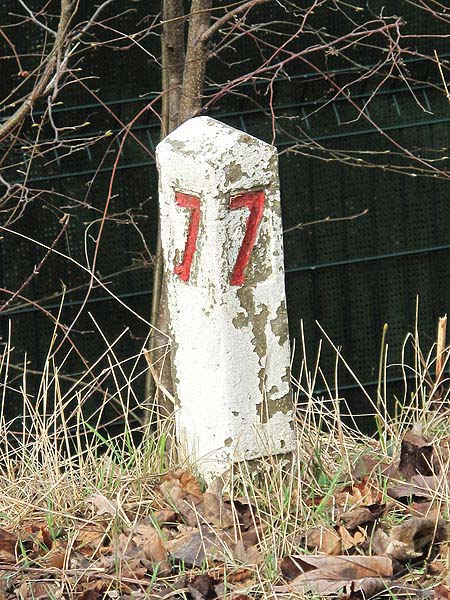 This photo shows the number 7 on an old marker post.