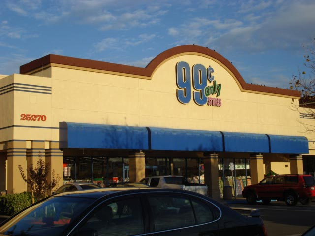 This photo shows the number 99 as part of retail signage for a 99 cent store.
